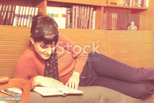 Retro woman enjoying reading at home.