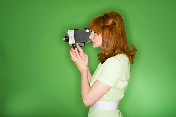 Retro woman filming stock photo
