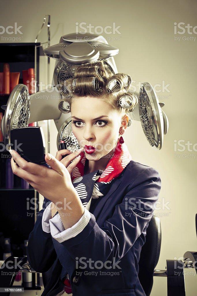 Retro woman in a hair salon royalty-free stock photo