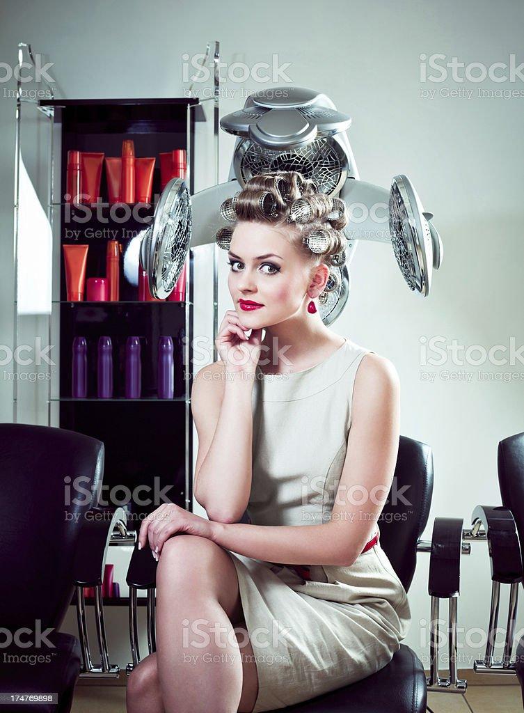 Retro woman in a hair salon stock photo