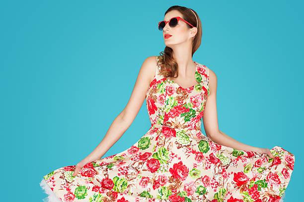 Retro woman in floral dress picture id525973626?b=1&k=6&m=525973626&s=612x612&w=0&h=b6lvasn22xet81d7q84fmjzfsrrfrlvts70zafklaeg=