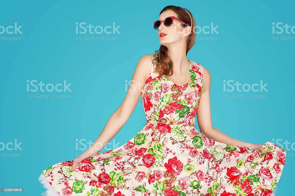 Retro Woman In Floral Dress stock photo