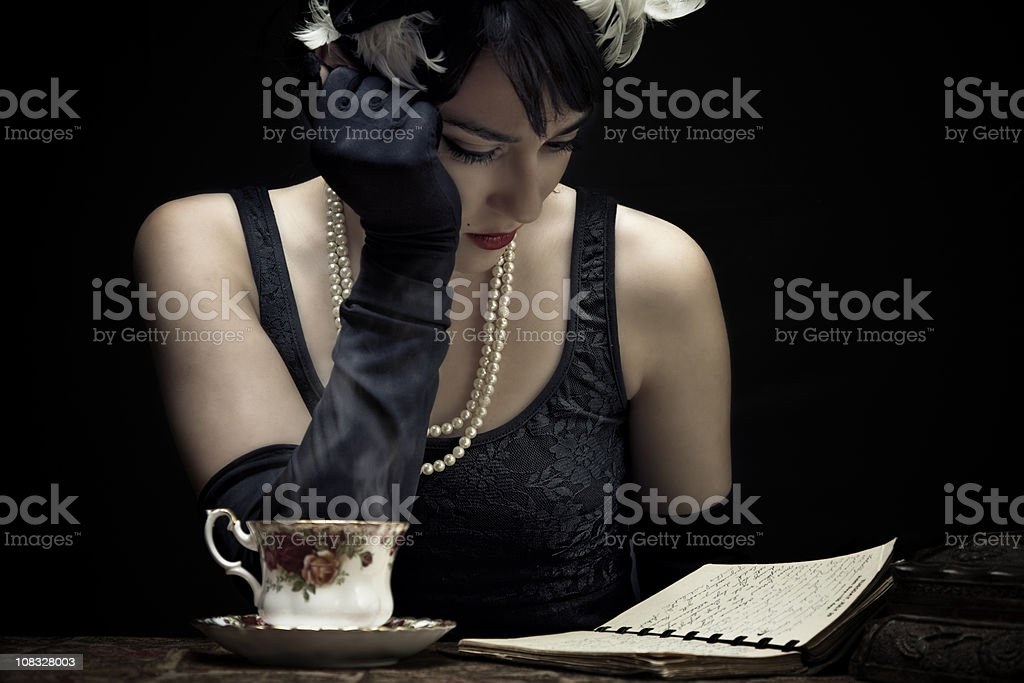 Retro woman looking old letters royalty-free stock photo