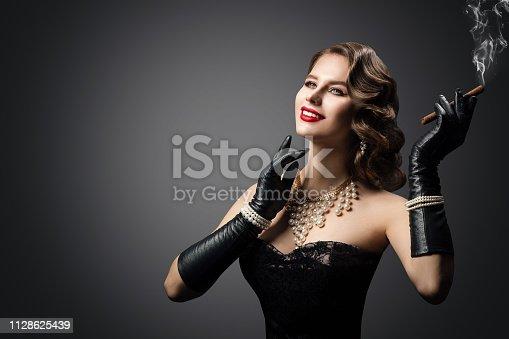 Retro Woman Smoking Cigar, Happy Fashion Model Beauty Portrait, Beautiful Girl Gloves, Luxury Pearl Jewelry, over studio gray background