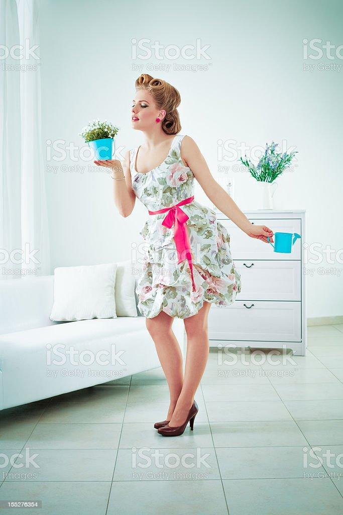 Retro woman watering flower stock photo