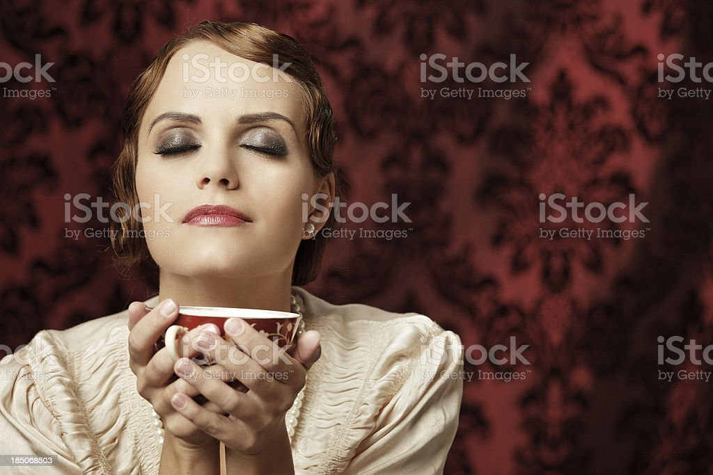 Retro woman with a cup of tea stock photo