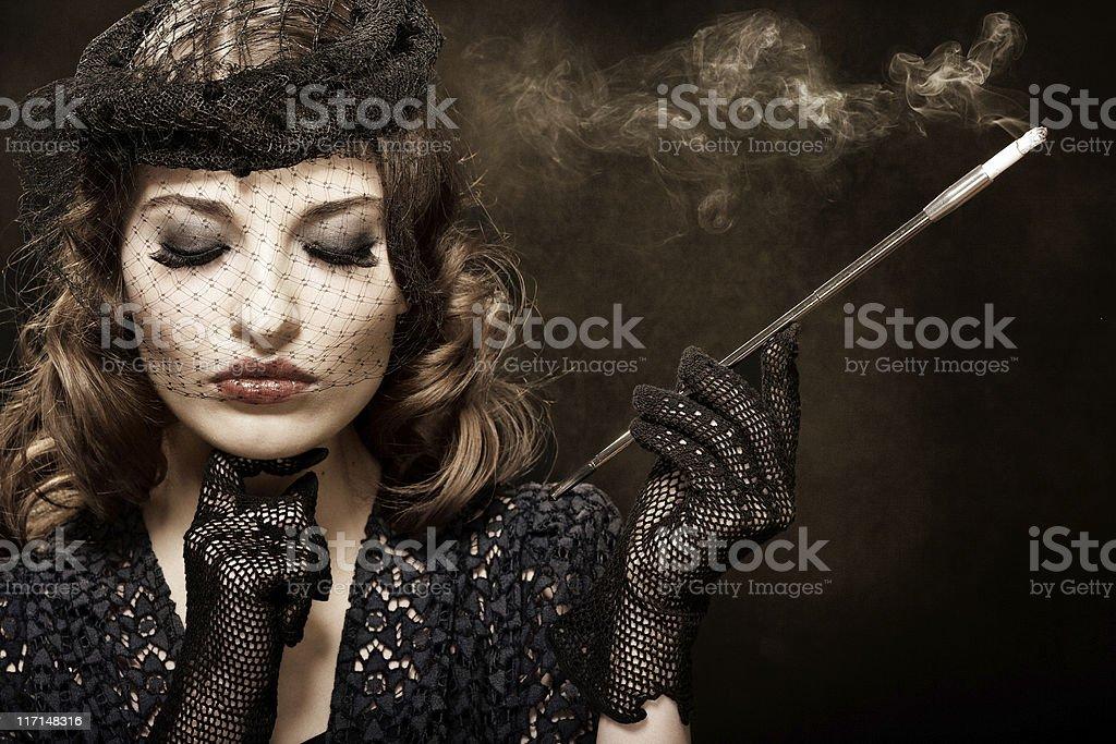 Retro woman with cigarette holder stock photo