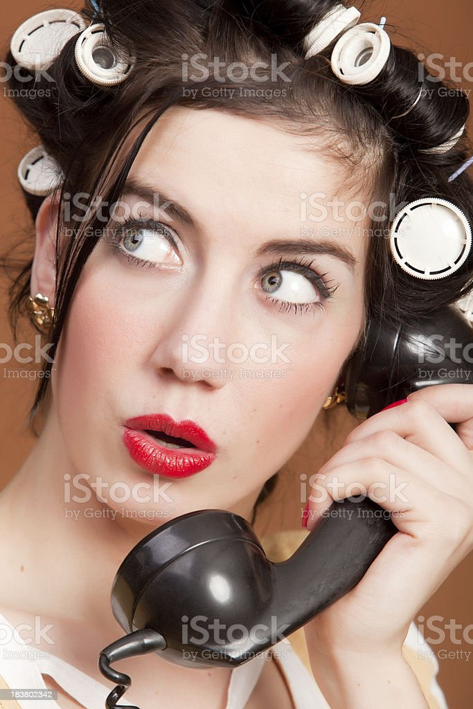 Retro woman with curlers and telephone stock photo