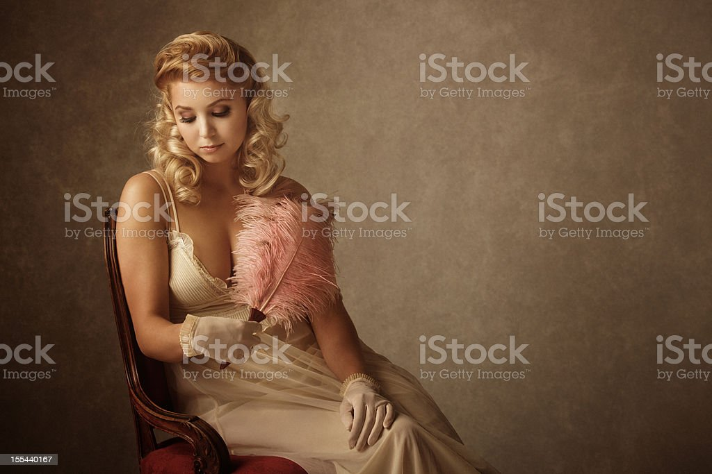 retro woman with feather fan royalty-free stock photo