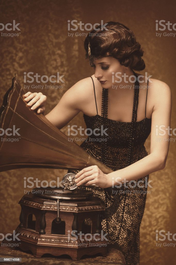 Retro woman with gramophone stock photo