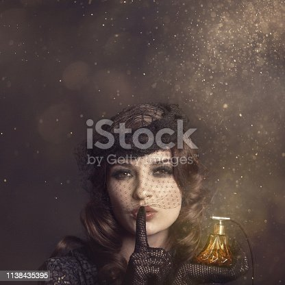 VIntage photo of a woman with a perfume sprayer