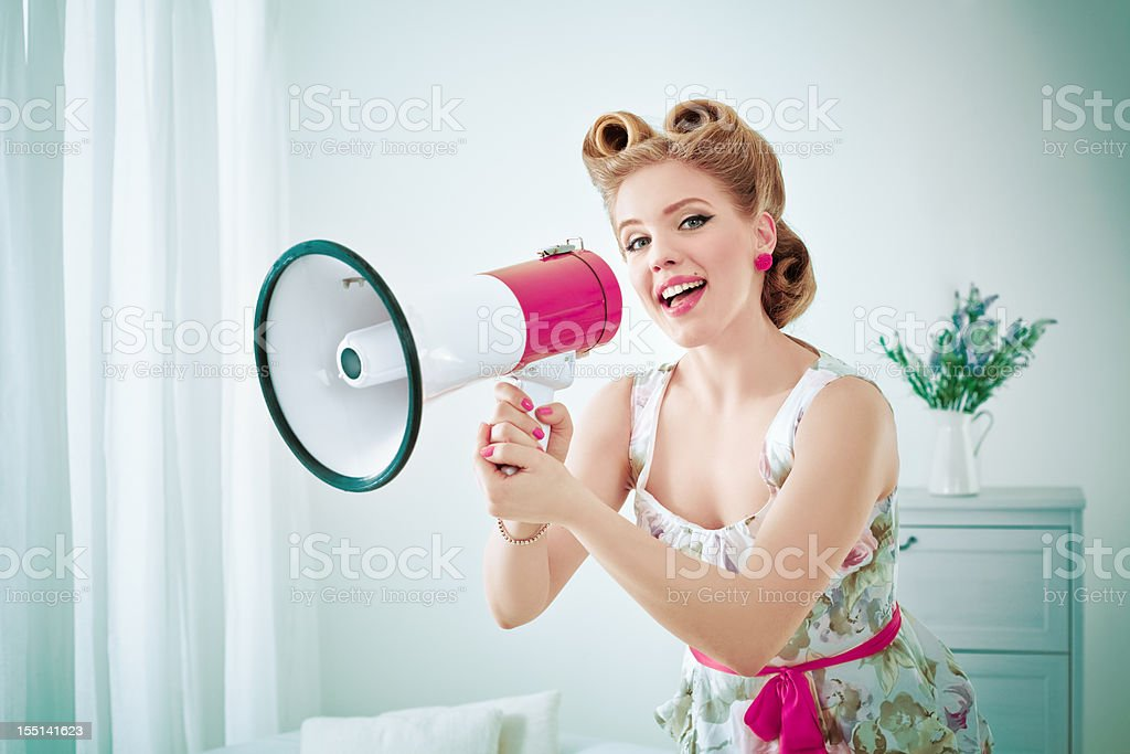 Retro woman with megaphone stock photo