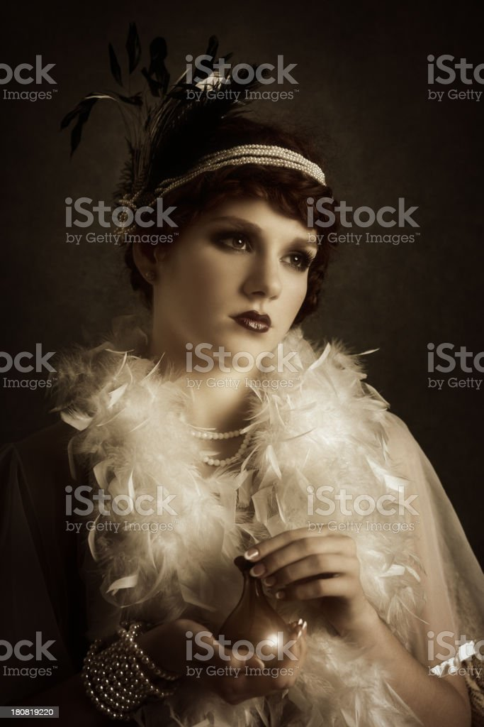 retro woman with perfume bottle royalty-free stock photo