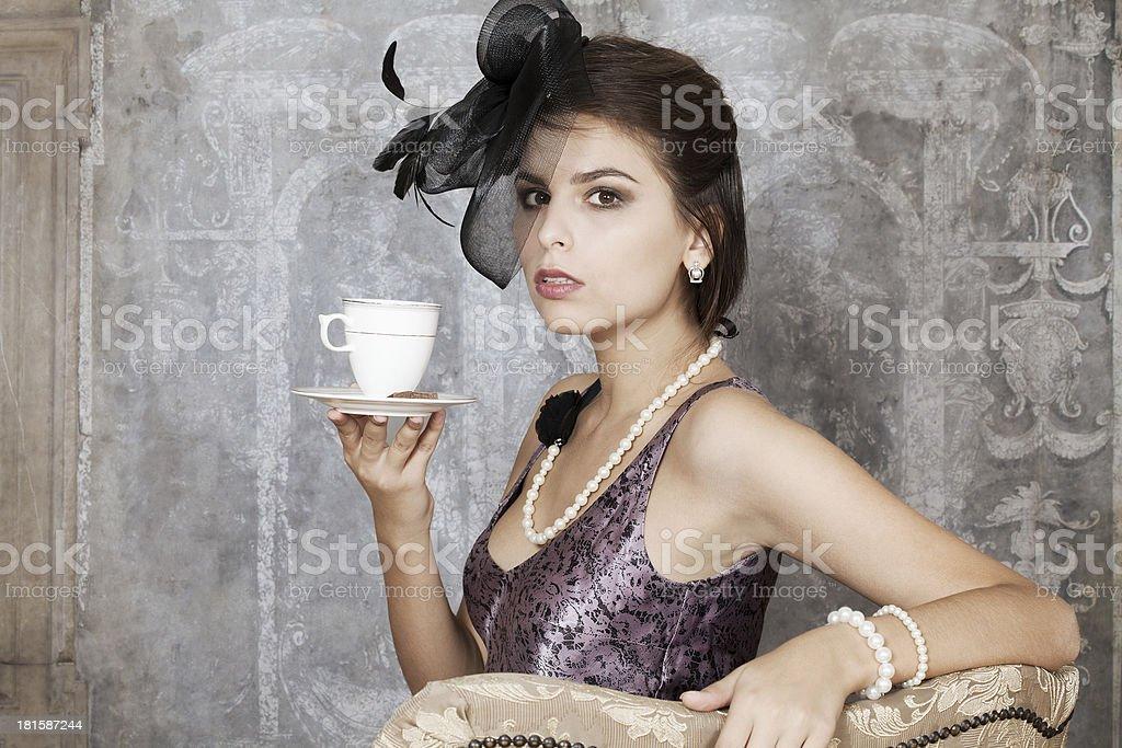 Retro woman with tea royalty-free stock photo