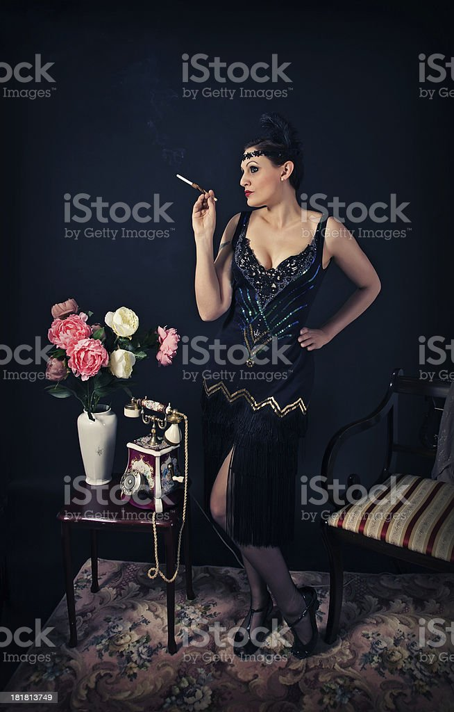 Retro women with sigarette in a holder 1920 style stock photo