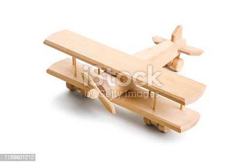Retro wooden airplane isolated on white background.