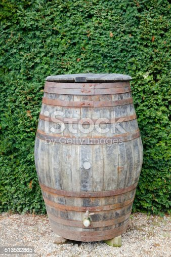 retro wooden barrel used as a water butt in garden