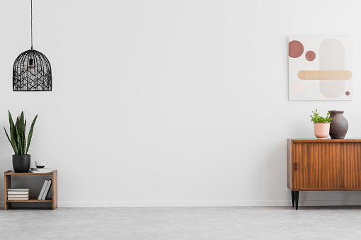 Retro Wooden Cabinet And A Painting In An Empty Living Room Interior With White Walls And Copy Space Place For A Sofa Real Photo — стоковые фотографии и другие картинки Без людей
