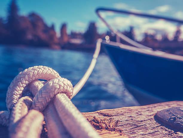 retro yacht in harbor - aangemeerd stockfoto's en -beelden