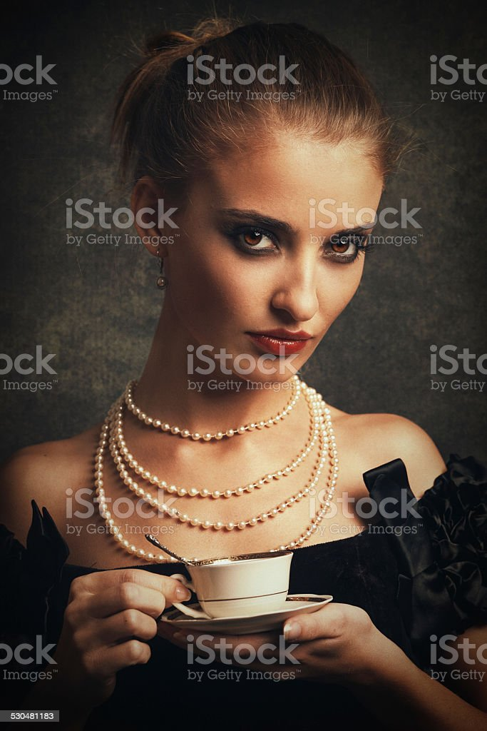 retro young woman drinking coffee stock photo