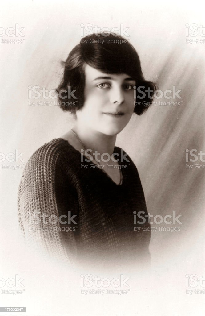 Retro Young Woman An old portrait of a young woman from the roaring 1920's era. 18-19 Years Stock Photo
