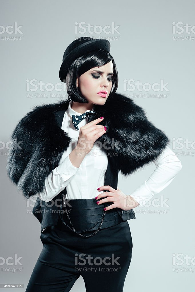 35eb7bab733 Retro Young Woman Wearing Black And White Clothes Stock Photo   More ...