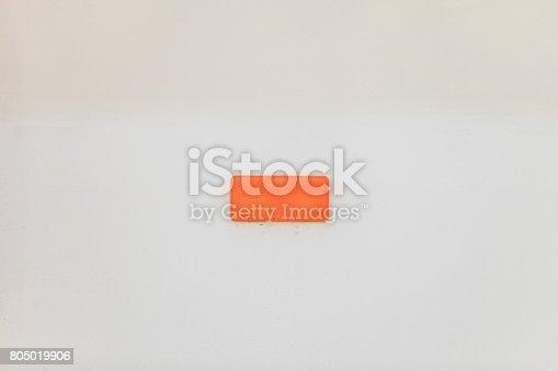 Retroreflector on white background. Small reflecting light cataphote.