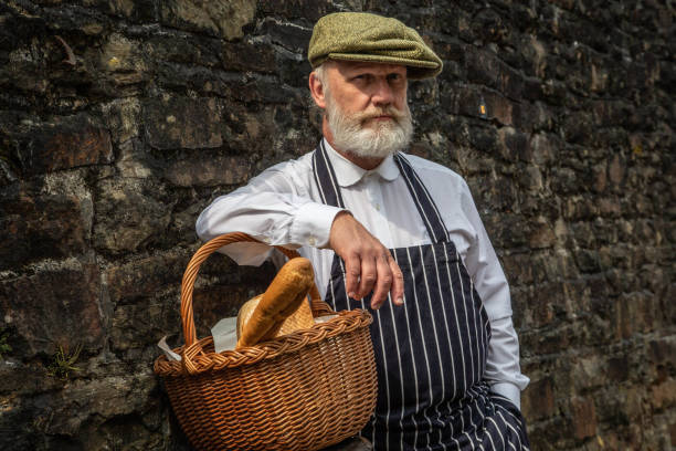 Retro-style baker selling bread Retro-style baker selling bread from bicycle basket war effort stock pictures, royalty-free photos & images