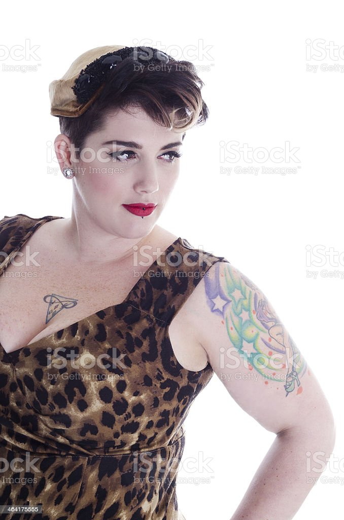 Retro-styled beauty looking to side with appraising expression. royalty-free stock photo