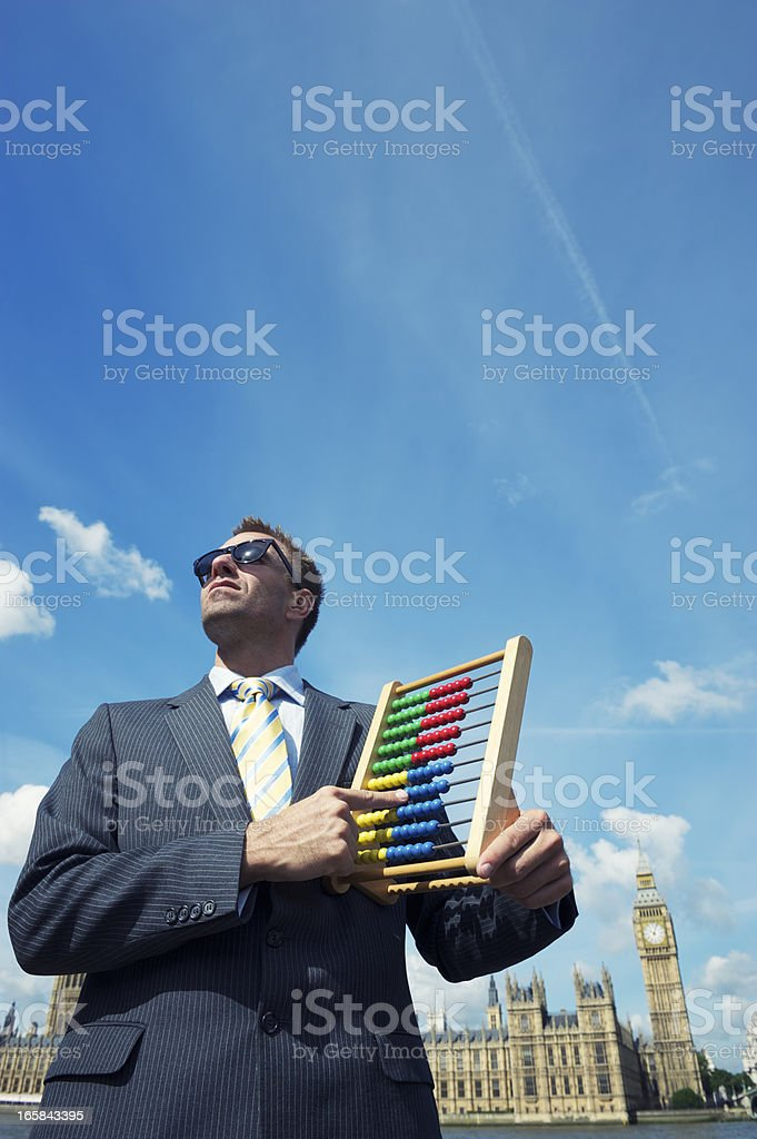 Returning Officer Holds Abacus at Houses of Parliament stock photo