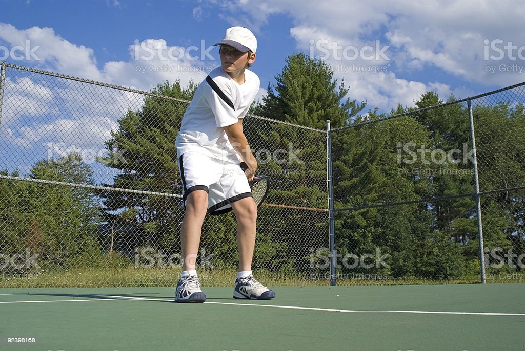 Returning the Tennis Ball royalty-free stock photo