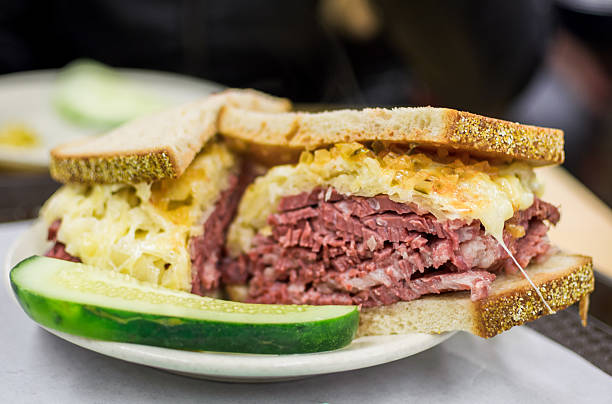 reuben sandwhich with pickle - pastrami stock pictures, royalty-free photos & images