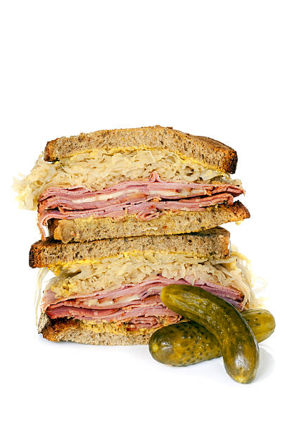 reuben sandwich isolated on white - pastrami stock pictures, royalty-free photos & images