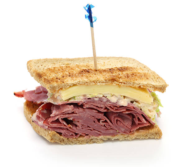 reuben sandwich with pastrami and swiss cheese - pastrami stock pictures, royalty-free photos & images