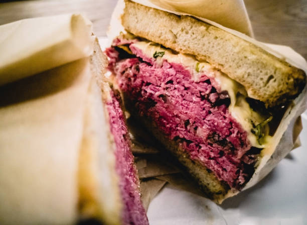 reuben sandwich with pastrami - pastrami stock pictures, royalty-free photos & images