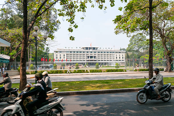 reunification palace in ho chi minh city, vietnam - motorbike, umbrella stock pictures, royalty-free photos & images