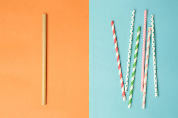 Reusable bamboo straws as an alternative for single-use plastic straws Reusable bamboo straws as an alternative for single-use plastic straws drinking straw stock pictures, royalty-free photos & images