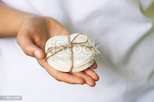 istock Reusable cotton pads in the woman's hand 1169442287