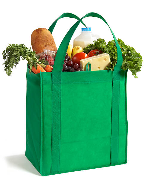 Reusable Eco Friendly Grocery Bag A reusable and recyclable grocery bag filled with food. bag stock pictures, royalty-free photos & images