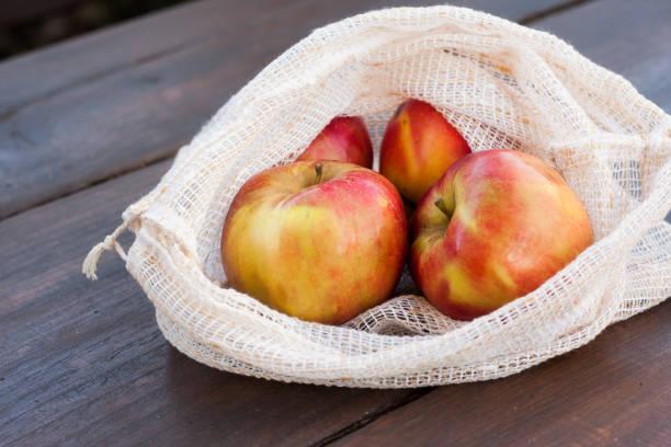 Reusable, environmentally friendly pretty produce shopping bags stock photo