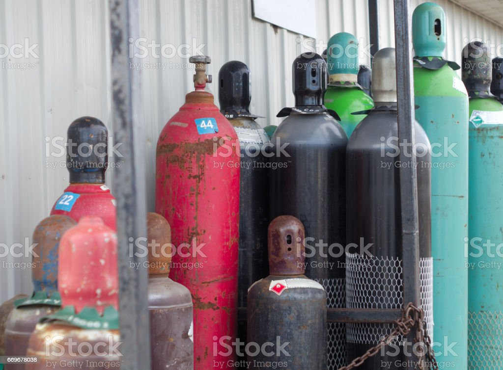 reusable gas tanks refills chemical products under pressure empty bottles stock photo