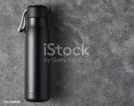 1129148925 istock photo Reusable water bottle on a concrete background 1254195859