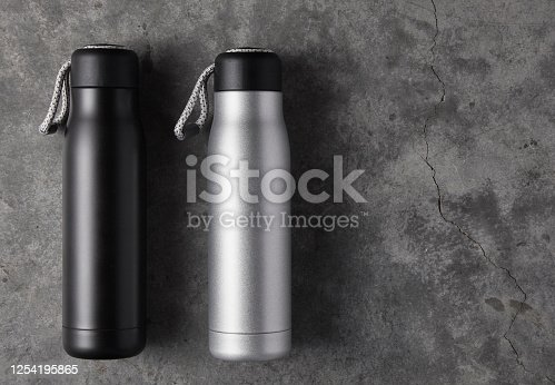1129148925 istock photo Reusable water bottle on a concrete background 1254195865