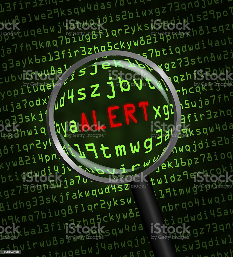 'ALERT' revealed in computer code through a magnifying glass stock photo