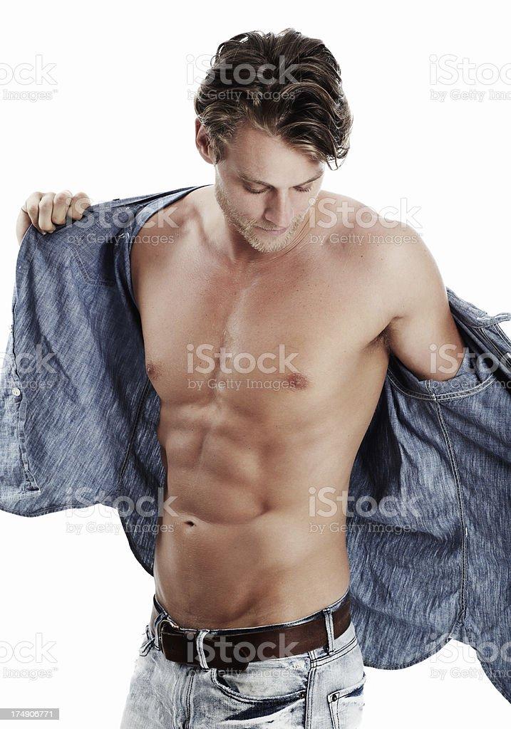 Revealing his rock hard abs stock photo