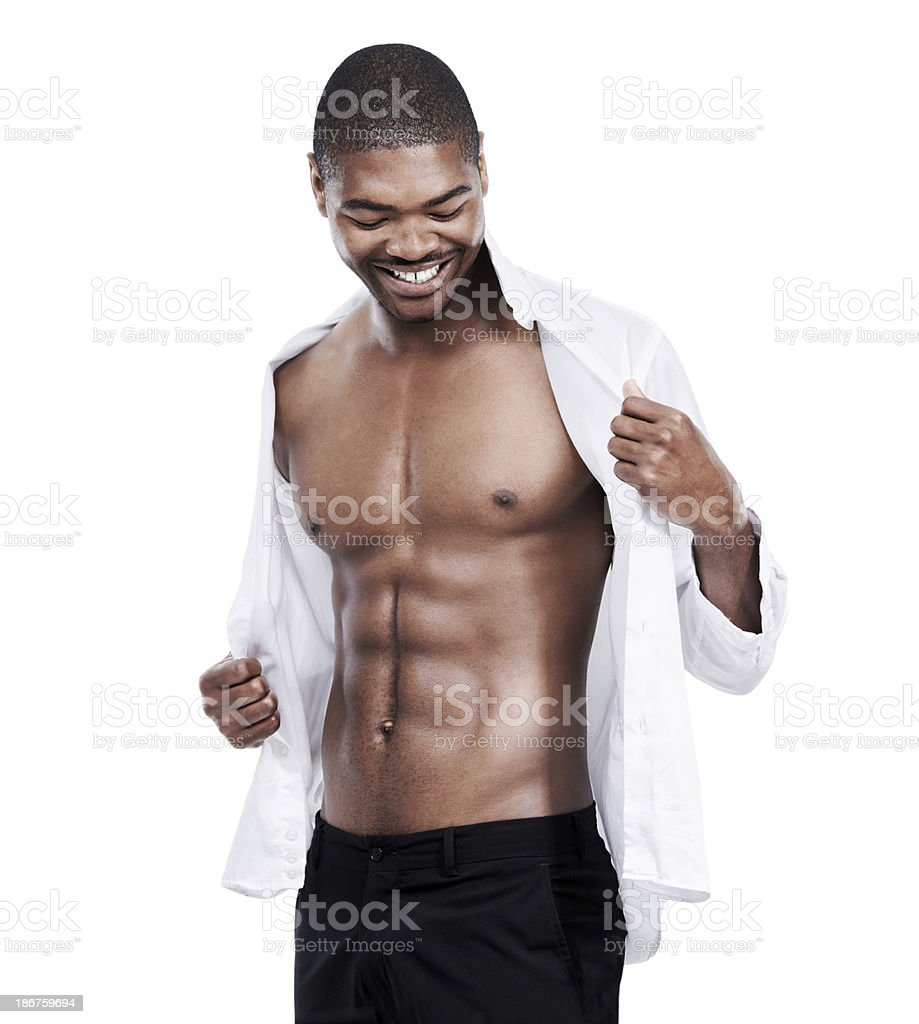 Revealing his toned body royalty-free stock photo
