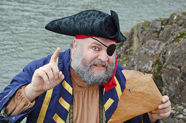 revealing secrets - swashbuckler stock photos and pictures