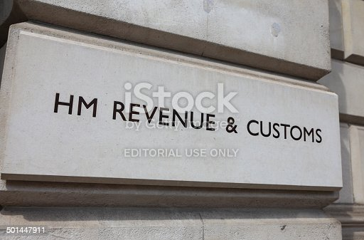 London, England - May 5th, 2014: Sign outside the offices of Her Majesty's Revenue and Customs along Whitehall in Central London. Formed by a merger of the Inland revenue and Customs and Excise the departments main responsibility is the collection of taxes.