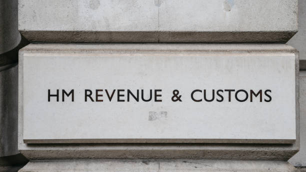 HM Revenue and Customs sign on a building in Whitehall, London, England, UK. stock photo