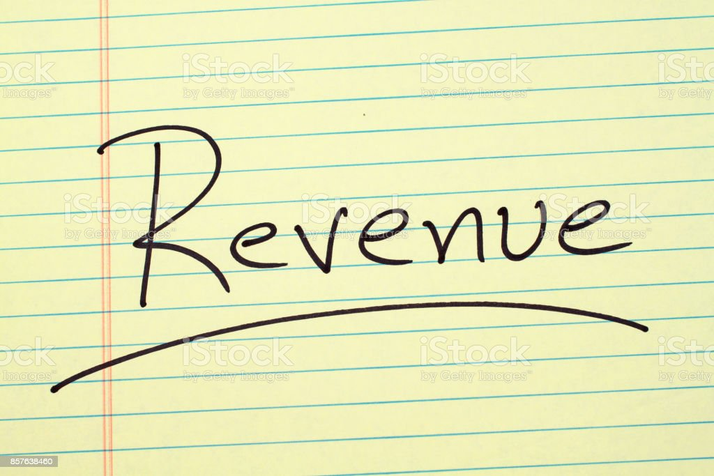 Revenue On A Yellow Legal Pad stock photo